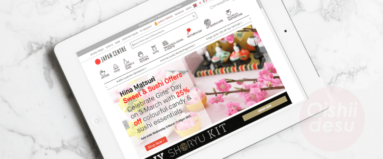 """Photo Description: the Japancentre ipad screenshot. The white page with black outlined illustrations minimize the visual clutter because of the monochromatic iconography. On the landing page, they have a promotion of """"hina matsuri, sweet & sushi offers. Celebrate girls' day on 3 March with 25% off colorful candy & sushi essentials."""