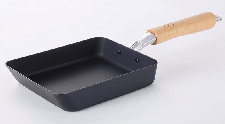 Photo Description: a TAKUMI Magma Plate tamagoyaki pan with their light colored wood handle.