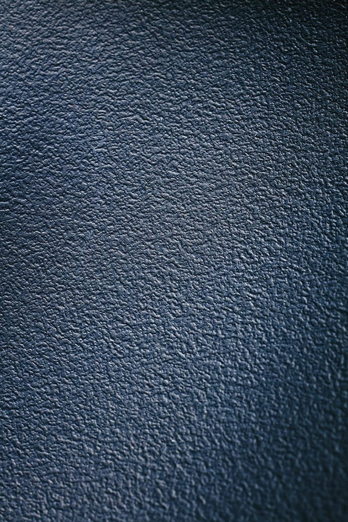 Photo Description: the surface of the TAKUMI iron Magma Plate looks like a very evenly applied stucco wall surface.
