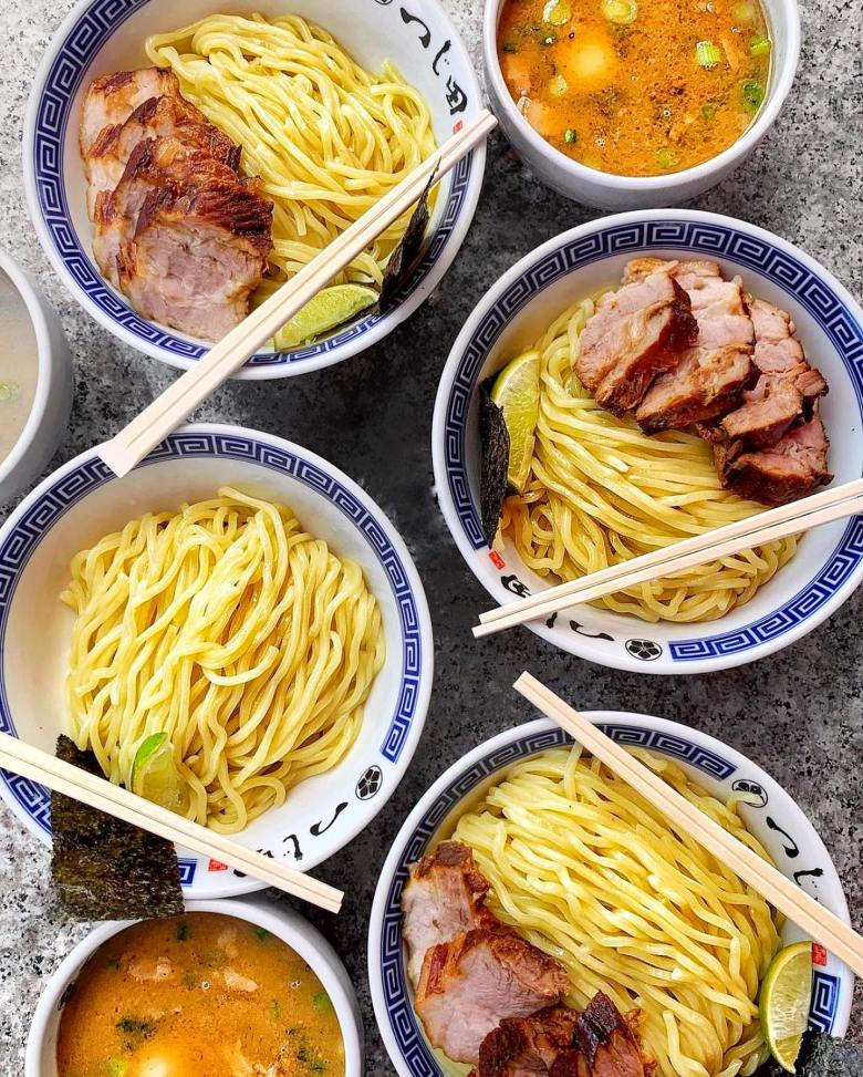 Photo Description: four bowls (I guess they aren't superstitious) of tsukemen from Tsujita artisan noodle in Los Angeles. The dipping noodles, along with the dipping stock.