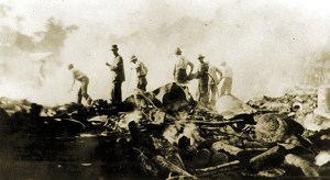 Men standing in the rubble of the Novemeber 28, 1917 Arcade fire.