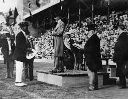Duke Kahanamoku (holding hat at left) at the 1912 Olympic Games in Stockholm, Sweden.