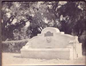 Lion head fountain on the horse trough, before the pergola was built.