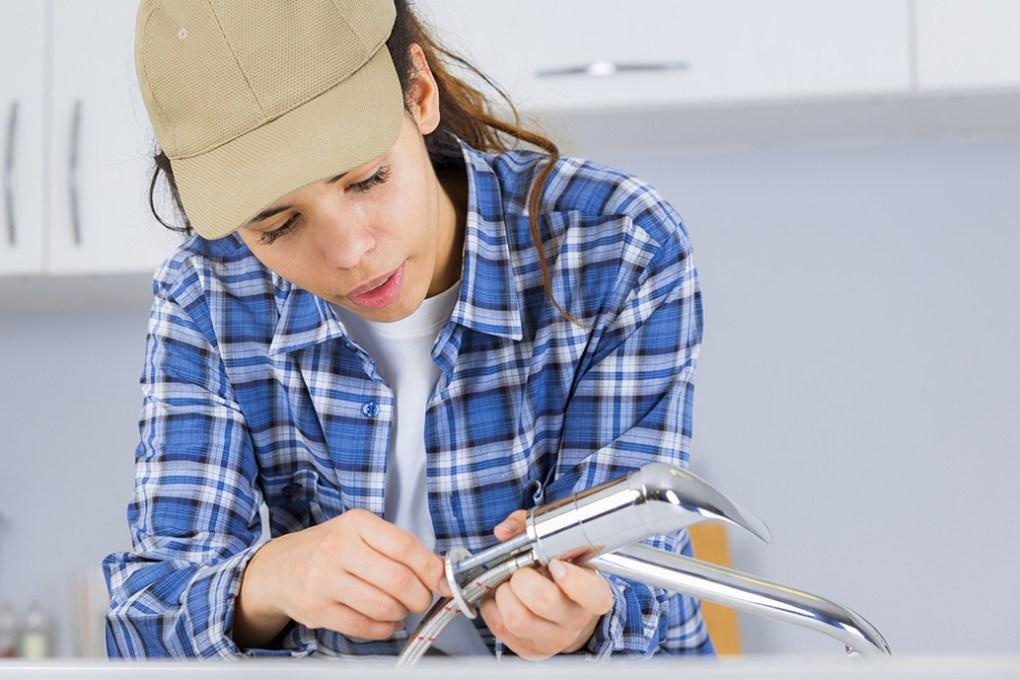 Female plumbing apprentice