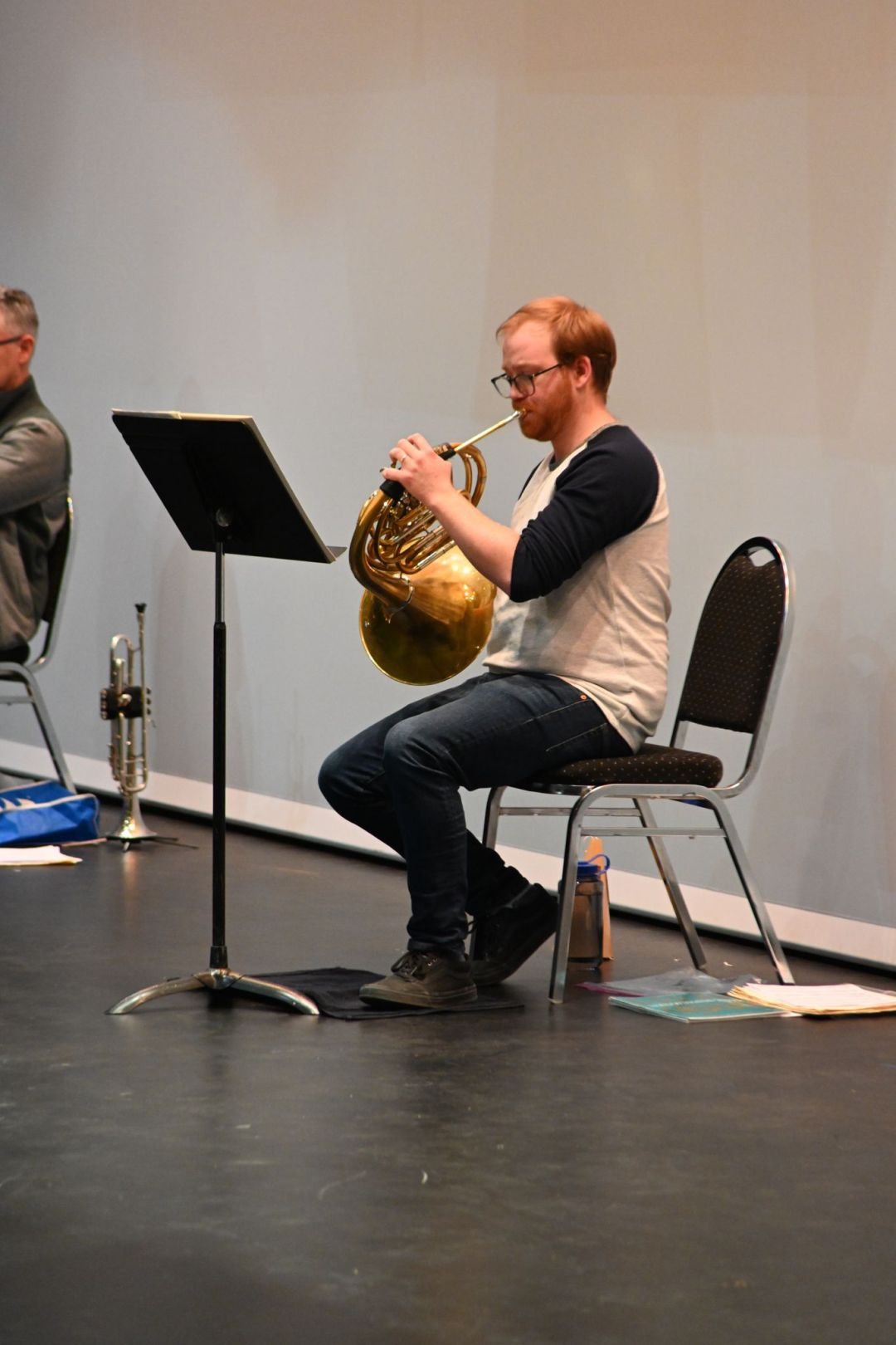 Sam McNally playing French horn in rehearsal