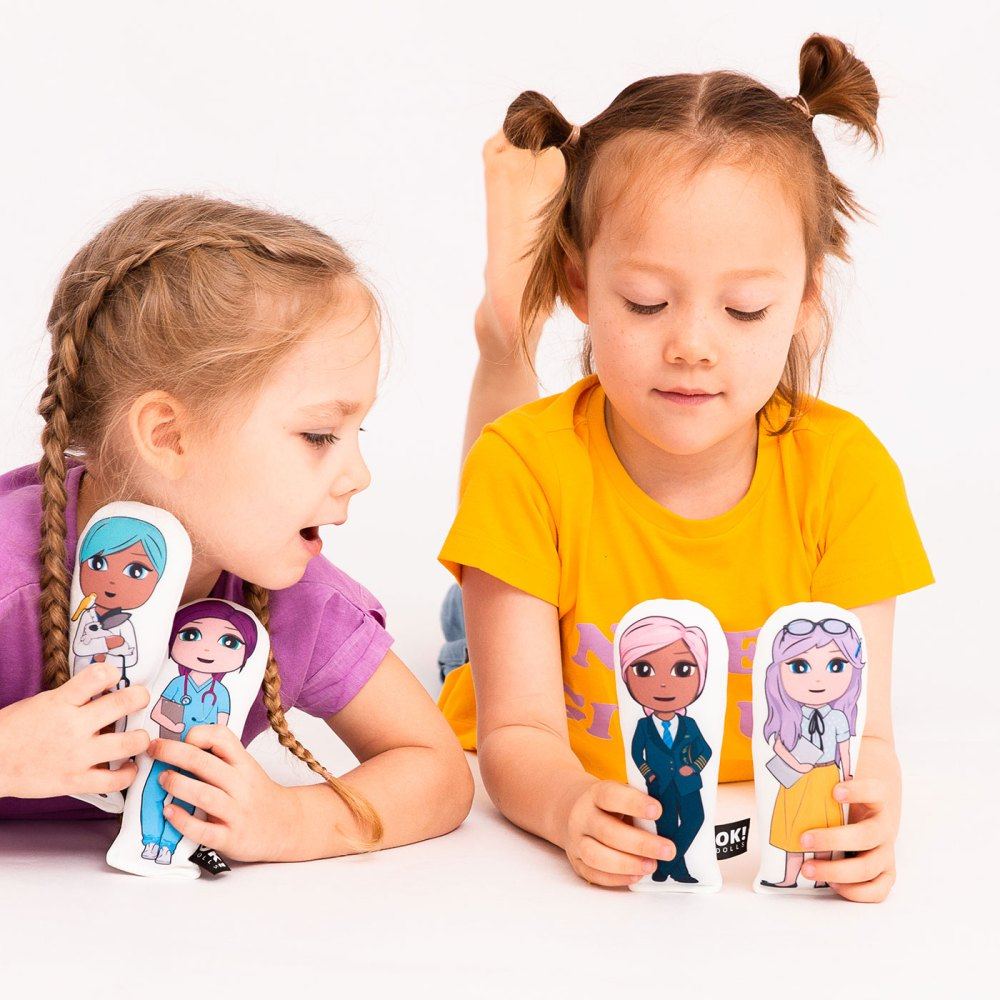 OKmini dolls. Two girls holding four OKMini dolls