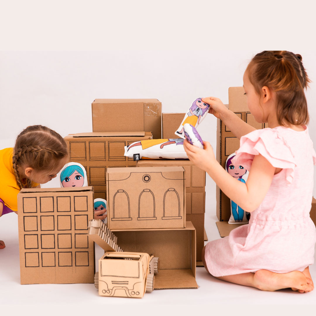 Cardboard buildings and girls pretend playing with OK!Dolls