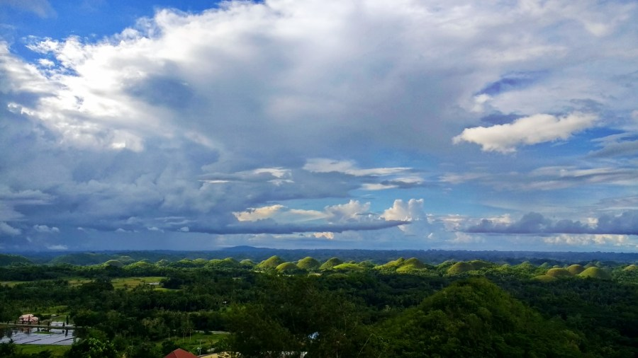 View of Chocolate Hills and neat clouds from the top.