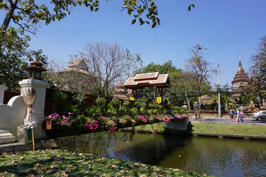 Old town Chiang Mai is surrounded by canals with beautiful flowered bridges to cross.