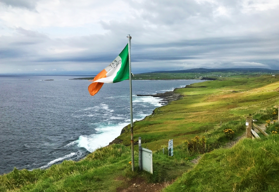 The Irish flag flys at a viewpoint of the Cliffs of Moher, just south of Doolin, Ireland.