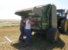 Clayton and Wade replacing wrap in the baler.