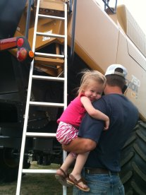 Our daughter Trale' loves her daddy. She's a farm girl!