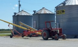 The tractor and auger by the bins, standing by for harvest.