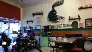 Ever been in a cafe that had two motorcycles parked on a stage with a train painted on the wall?