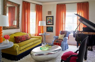 These 6 Lessons in Color Will Change the Way You Decorate     One     Mele added a decorative fringe to the sofa and a skirt to the armchair to  reduce