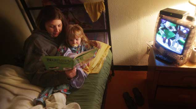 Megan Olmstead reads with her daughter, Chloe, before bed at Center Point therapeutic center in Tulsa on Jan. 17, 2010. Olmstead is the first woman in Oklahoma Department of Corrections history to have her child live with her while still in custody. Olmstead holds a job and plans to be out of Center Point in March 2011.