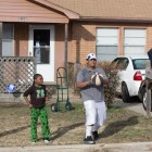 Greg and Keta Rogers, who live with their three children in Del City, are uninsured and may remain so next year in the wake of Gov. Mary Fallin's decision not to expand Medicaid. Here, Greg plays ball with his 12-year-old son Elisha (left) and nephew Kaleb Pennon.