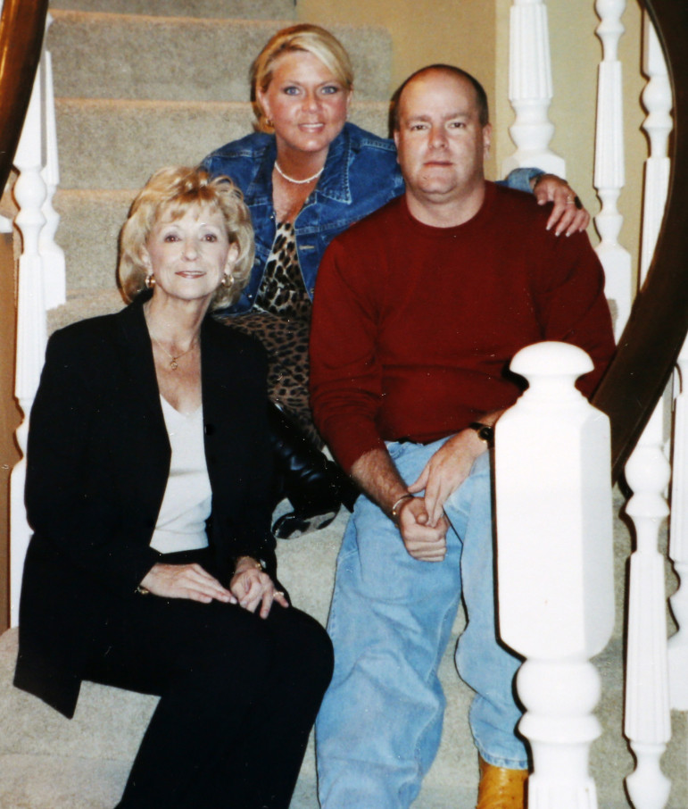 Dena Kay Brasfield, center, poses for a family portrait with mother Genevieve and brother Curtis several years before her 2010 death from a prescription drug overdose.