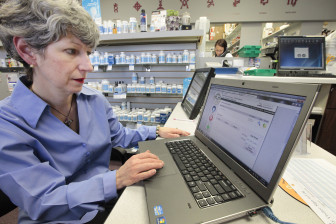 Mary Jane Fry of  Medic Pharmacy in Oklahoma City enters information in Oklahoma's Prescription Monitoring Program.