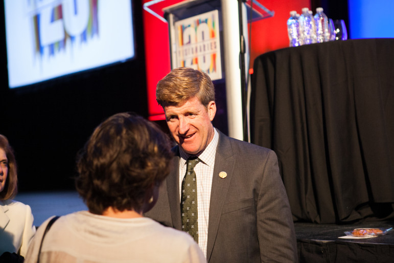 Former U.S. Rep. Patrick Kennedy speaks with an attendee at the Zarrow Mental Health Symposium.