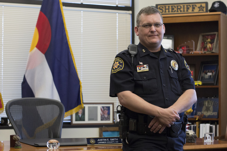 Larimer County Sheriff Justin Smith and 11 other sheriffs from Colorado, Nebraska and Oklahoma, sued Gov. John Hickenlooper over Colorado's marijuana laws.