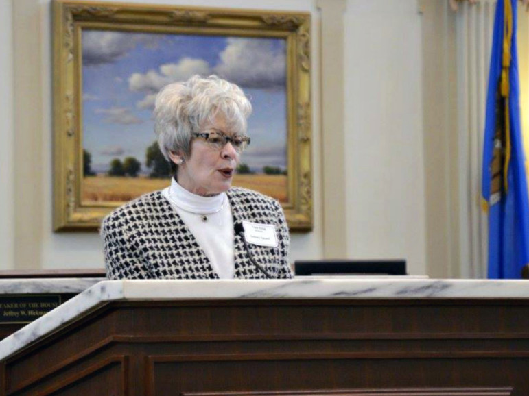 Trish Emig, a participant in a coalition that is critical of the state's move toward managed care for Medicaid participants, speaks during Senior Day at the State Capitol earlier this year.