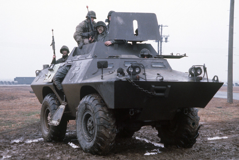 Security policemen aboard an armored vehicle participate in an exercise.