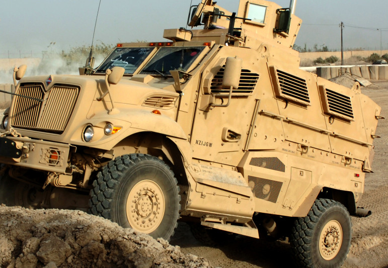 Soldiers at Camp Liberty drive a brand new mine resistant and ambush protected vehicle through an off-road confidence course at Camp Liberty on Nov. 23, 2015.