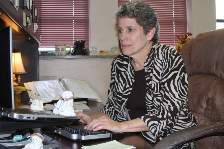 Teri Bell, executive director of student support services at Oklahoma City Public Schools, works at her desk in Oklahoma City Public Schools' administration building.