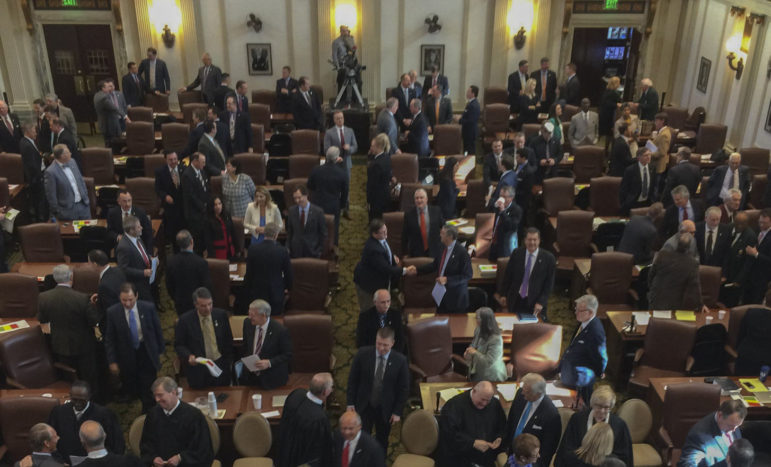 """Legislators, judges and state officials converse in the House chambers after Gov. Mary Fallin's """"State of the State"""" address on Feb. 1."""