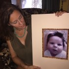 Erin Taylor with portrait of her son