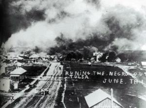 """Black Wall Street"" is burnt down during the Tulsa Race Massacre. Image courtesy of Oklahoma Historical Society Research Division."