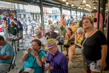 Visitors to the French Market enjoying tastes of traditional German food
