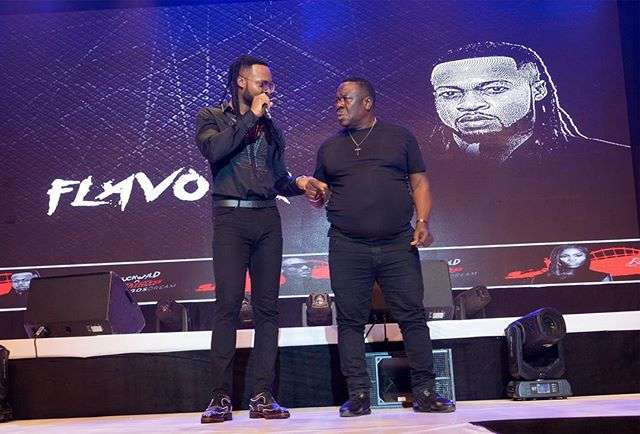 """Flavour and John 'Mr Ibu' Okafor performing at the Buckwyld and Breathless concert, """"The Lagos Dream."""""""