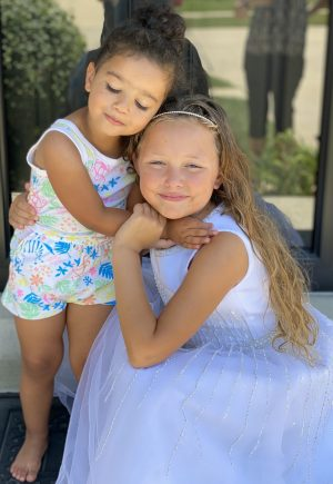 Sisters Evelyn and Stella Besse hug each other.