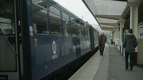 alan arrives on the train