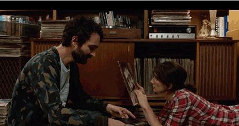 Josh and Ali bonding over old vinyl