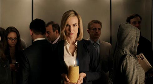 woman in elevator holding a candle