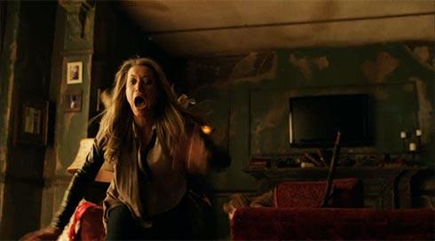 Lauren grabs the ouija board