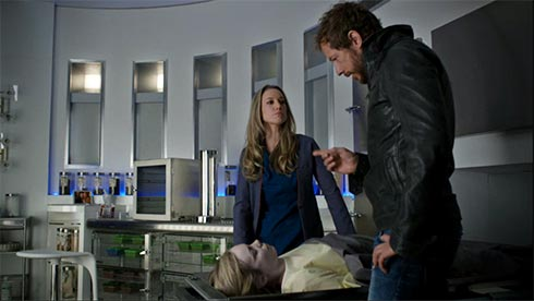 Lauren and Dyson look at a dead Fae woman