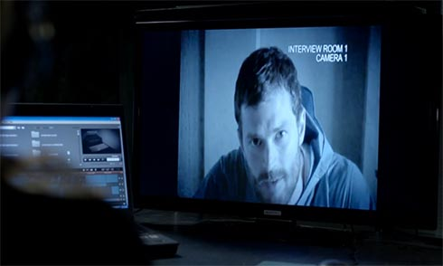Paul Spector looks at the camera