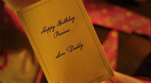 "A card that says ""Happy Birthday Princess. Love, Daddy"""
