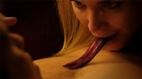 A girl with a long, snake's tongue