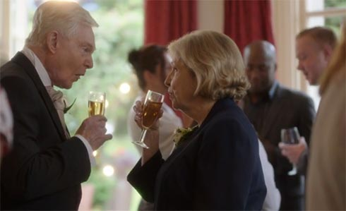 Alan and Celia drink a toast