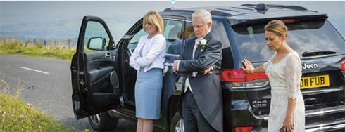 Caroline, Alan and Gillian beside the Jeep