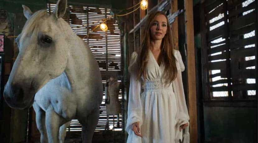 Kenzi in a white dress with a white horse