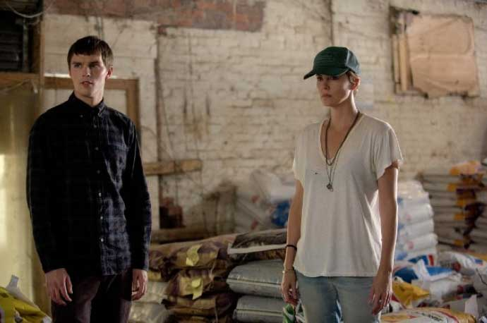 Still of Charlize Theron and Nicholas Hoult in Dark Places