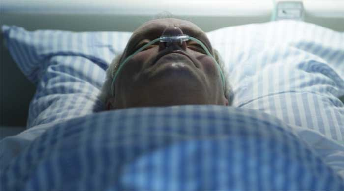 Dicte's father in a hospital bed