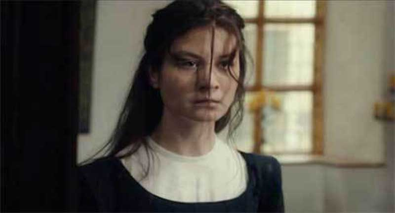 Malin Buska as Kristina, Queen of Sweden, in The Girl King