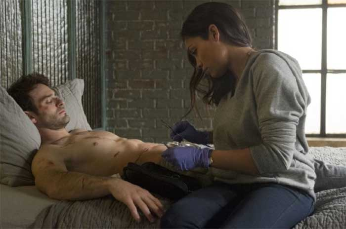 Charlie Cox and Rosario Dawson in Daredevil